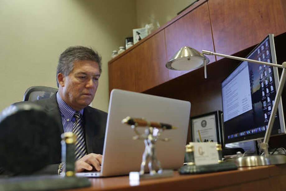 In this Sept. 12, 2016, photo, Rocky Finseth, president at Carrara Nevada, works in his office in Las Vegas. The fall is an anxious time for many small and medium-sized business owners as they wait to learn whether their health insurance costs will go up for 2017. Some, like Finseth, end up paying less. (AP Photo/John Locher)
