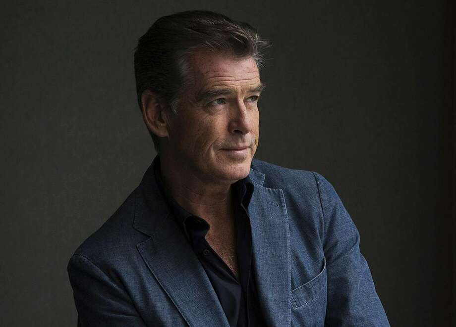 "This Sept. 9, 2012 file photo shows actor Pierce Brosnan during a photo shoot to promote the movie ""Love is All You Need"" at the 2012 Toronto International Film Festival in Toronto. Brosnan's daughter Charlotte died in London on June 28, after battling ovarian cancer, his publicist confirms. She was 41. Brosnan's first wife Cassandra Harris, Charlotte's mother, also died from ovarian cancer in 1991. (AP Photo/The Canadian Press, Michelle Siu, File)"