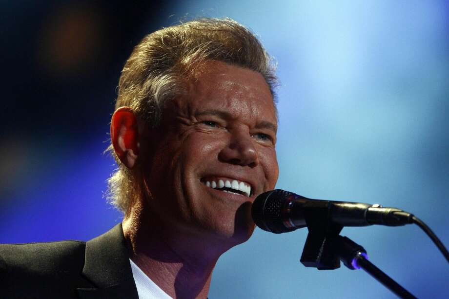 In this June 7, 2013 file photo, Randy Travis performs on day 2 of the 2013 CMA Music festival at the LP Field in Nashville, Tenn. Publicist Kirt Webster on Wednesday night, July 10, 2013 said that the 54-year-old Travis is in surgery after suffering a stroke while he was being treated for congestive heart failure because of a viral illness. (Photo by Wade Payne/Invision/AP, File)
