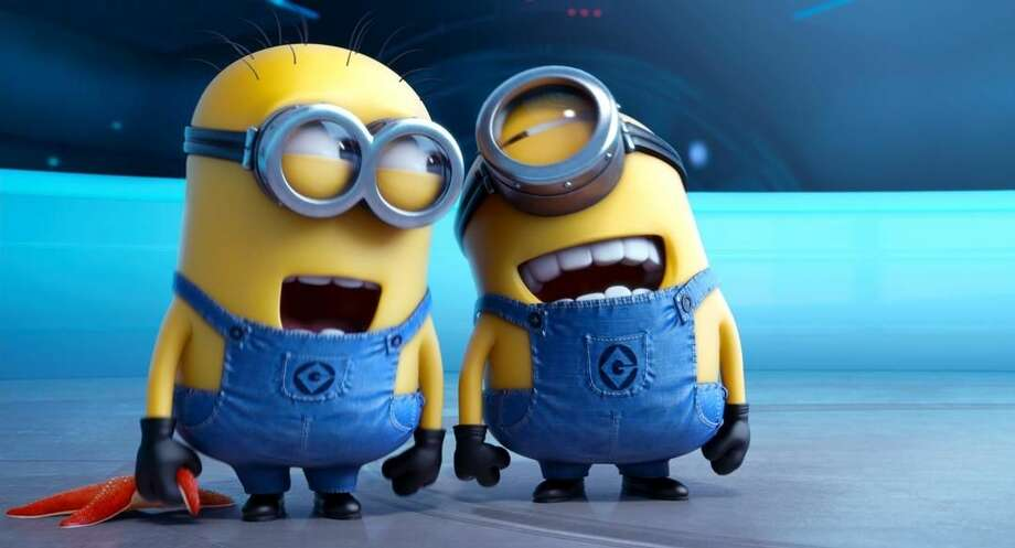"The minion characters in the film ""Despicable Me 2"" are shown. Domestic box office numbers so far on this long Fourth of July holiday weekend are suggesting the the animated minions of family favorite, with a price tag one third of what ""The Lone Ranger"" cost to make, is outperforming the masked man by more than three to one. (AP Photo/Universal Pictures, File)"