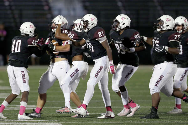 10/21/16 : Pearland's Derek Parish (16) is congratulated by teammates after recovering a George Ranch fumble in the first half at the Rig on Friday, October 21, 2016 in Pearland, TX. (PhotoFor the Chronicle by Thomas B. Shea)