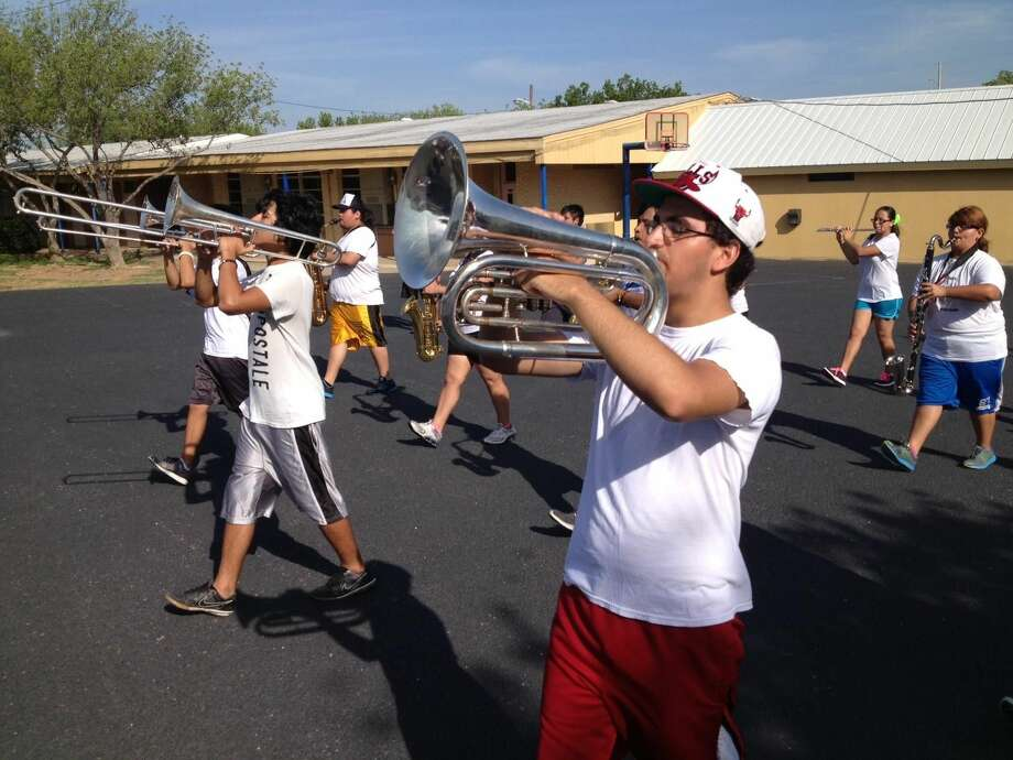 The Martin High School Marching Band prepares for their 2013-2014 school year Wednesday morning by holding a service/leadership retreat at the Mary Help of Christians campus.(Photo by Cuate Santos/Laredo Morning Times)