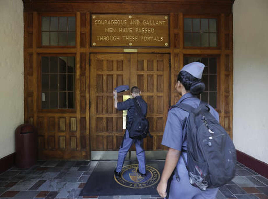 In this Thursday, Sept. 8, 2016 photo, a cadets walk into the academic building at the New York Military Academy in Cornwall-on-Hudson, N.Y. While Republican presidential nominee, Donald Trump, talks tough about dealing with China, his old military prep school is building bridges to that country. The New York Military Academy began classes this fall with new Chinese backing and a former New York City high school principal originally from China in charge. (AP Photo/Mike Groll)