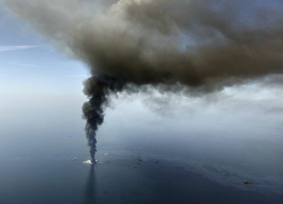 In this April 21, 2010 file photo, the Deepwater Horizon oil rig burns in the Gulf of Mexico. (AP Photo/Gerald Herbert, File)