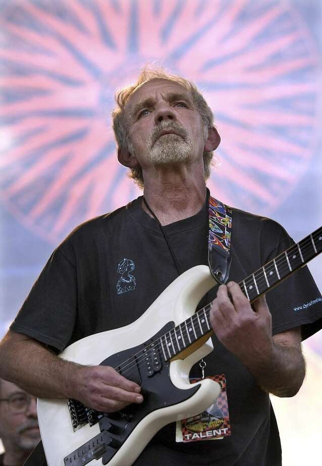 "In this June 5, 2004 file photo, singer-songwriter J.J. Cale plays during the Eric Clapton Crossroads Guitar Festival in Dallas, Texas. Cale, whose best-known songs became hits for Eric Clapton with ""After Midnight"" and Lynyrd Skynyrd with ""Call Me the Breeze,"" has died. He was 74. Cale's manager Mike Kappus said the architect of the Tulsa Sound died Friday, July 26, 2013 of a heart attack at Scripps Hospital in La Jolla, Calif. (AP Photo/Tony Gutierrez, File)"