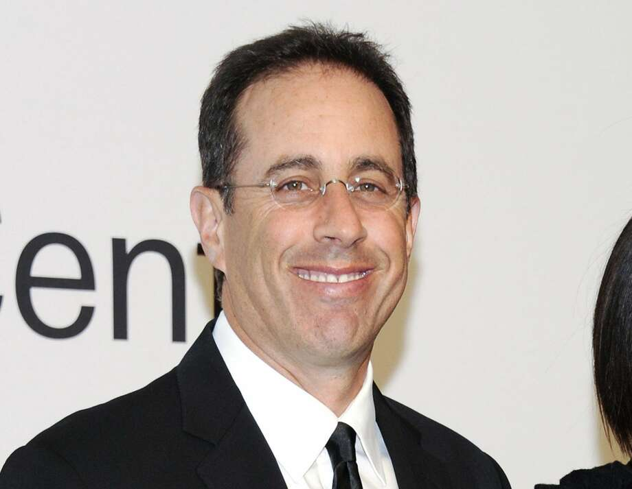 "This Oct. 24, 2011 file photo shows comedian Jerry Seinfeld attending ""Lincoln Center Presents: An Evening With Ralph Lauren"" at Alice Tully Hall in New York. Seinfeld announced Thursday, July 5, 2012, that he'll debut the Web series ""Comedians in Cars Getting Coffee"" on July 19. (AP Photo/Evan Agostini, file)"