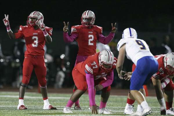 Judson backs Sincere McCormick and Julon Williams signal to the sidelines as Judson hosts Clemens at Rutledge Stadium on October 21, 2016