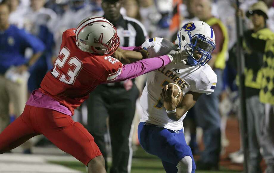 Clemens quarterback Frank Harris (right) is shoved out of bounds by Judson's Harold Watson on a play that resulted in Harris leaving the game with a knee injury at Rutledge Stadium on Oct. 21, 2016 Photo: Tom Reel /San Antonio Express-News / 2016 SAN ANTONIO EXPRESS-NEWS