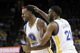 Ian Clark (21) pats Andre Iguodala (9) on the head after a missed shot during the first half as the Warriors played the Portland Trail Blazers during a pre-season game at Oracle Arena in Oakland, Calif., on Friday, October 21, 2016.