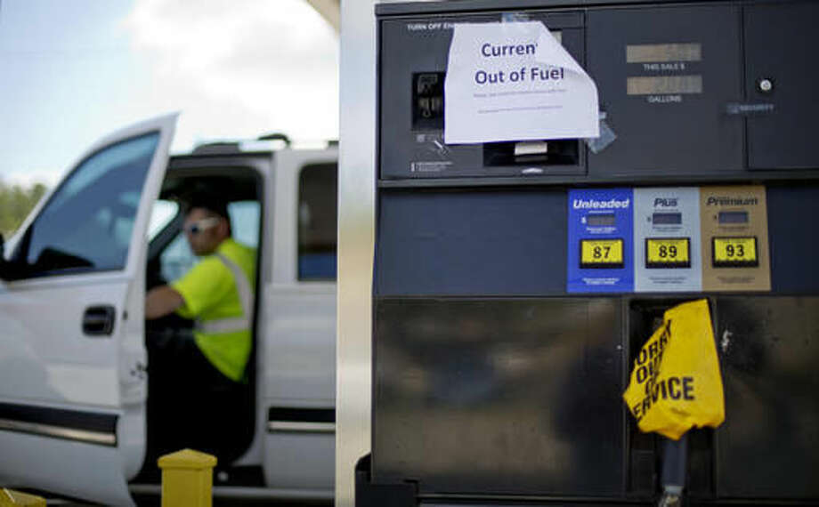 """A sign informs customers of a gas outage at a station in Smyrna, Ga., Monday, Sept. 19, 2016. Gas prices spiked and drivers found """"out of service"""" bags covering pumps as the gas shortage in the South rolled into the work week, raising fears that the disruptions could become more widespread. Georgia Gov. Nathan Deal issued an executive order Monday aimed at preventing price gouging. (AP Photo/David Goldman)"""