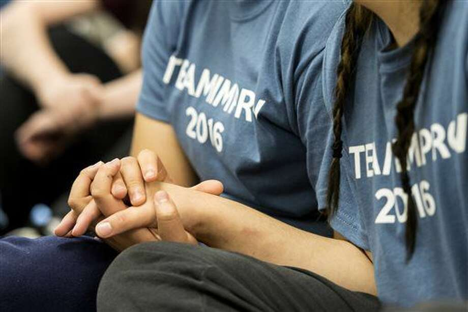 Two youth participants support one another by holding hands as they watch a performance dealing with the death of a loved one during the final day of the Improvisational Theater Camp on Thursday, Aug. 11, 2016, at the Youth Rehabilitation and Treatment Center in Geneva, Neb. The Youth Residential Treatment Center a division of the Nebraska Department of Health and Human Services, is where young women, ages 14 to 18, come for treatment, for help or safety, and to figure things out. (Kristin Streff/The Journal-Star via AP)