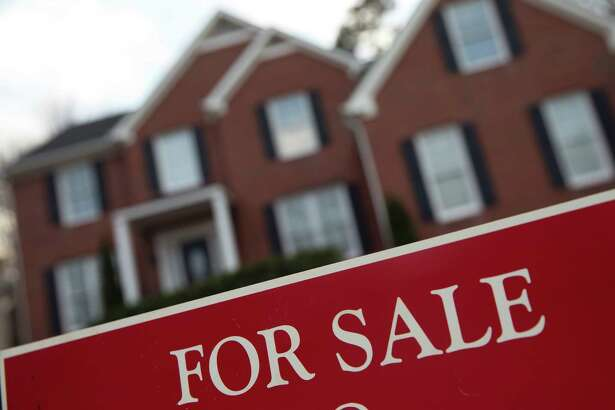 FILE - This Thursday, Dec. 3, 2015, file photo shows an existing home for sale in Roswell, Ga. On Thursday, Oct. 20, 2016, the National Association of Realtors reports on sales of existing homes in September. (AP Photo/John Bazemore, File)