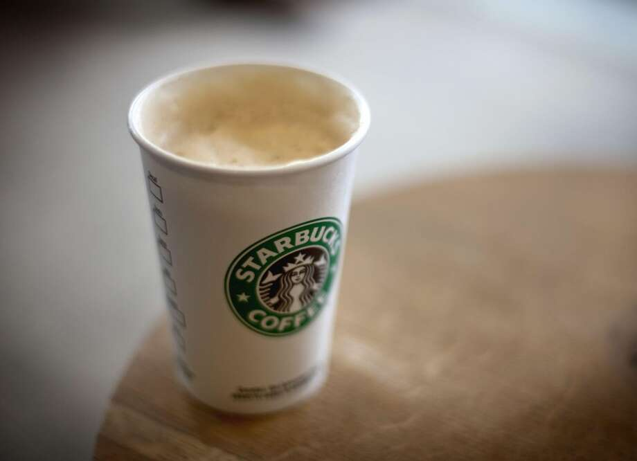 In this Wednesday, Jan. 26, 2011, photo, a cappuccino sits in a Starbucks store in Atlanta. Starbucks on Thursday, July 25, 2013, reported quarterly earnings that topped expectations. with stronger sales and lower costs lifting profits. (AP Photo/David Goldman)