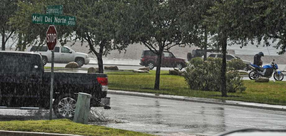 Heavy rain is shown Friday afternoon at the intersection of Esperanza Drive and Mall del Norte. The shower was brief, and the forecast only calls for a 20-30 percent chance of rain through Monday. (Danny Zaragoza/Laredo Morning Times)