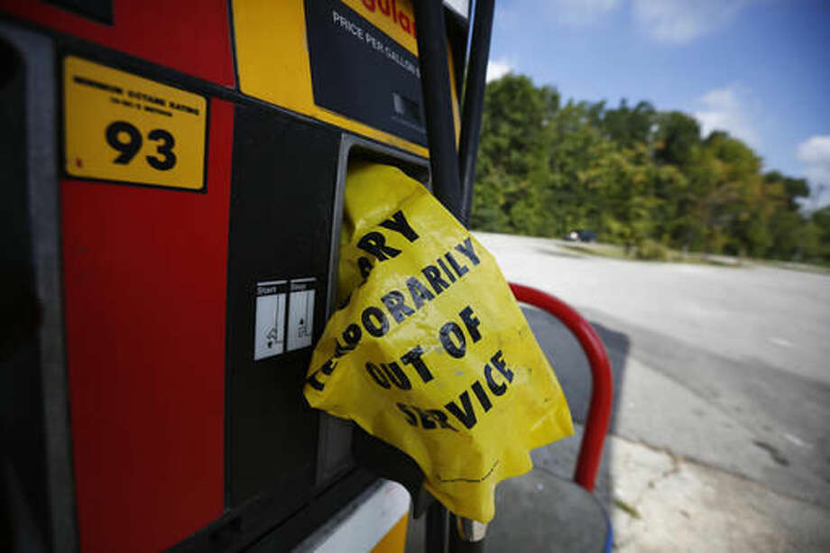 "A yellow bag reads ""sorry temporarily out of service"" informing customers of a gas outage at a station in Alabaster, Ala., on Monday, Sept. 19, 2016, Alabama Gov. Robert Bentley issued a state of emergency after a pipeline spill near Helena, Ala. Gas prices spiked and drivers found ""out of service"" bags covering pumps as the gas shortage in the South rolled into the work week, raising fears that the disruptions could become more widespread. (AP Photo/Brynn Anderson)"