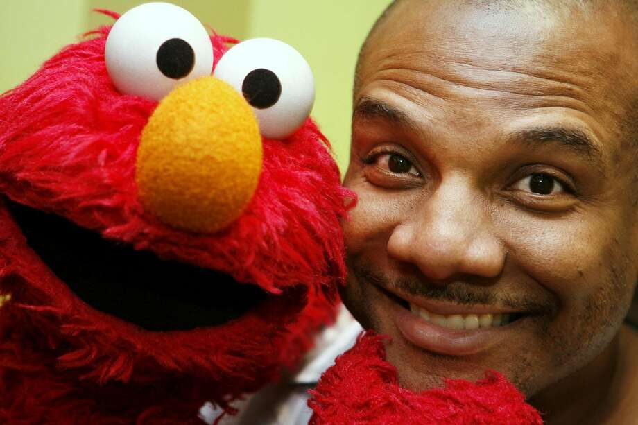 This Aug 16, 2006 file photo shows Kevin Clash, who was the voice and movements behind Sesame Street's Elmo, posing for a picture with Elmo in New York. Three lawsuits brought by men who said Clash sexually abused them when they were underage were tossed out by a federal judge who said in a decision published Monday, July 1, 2013, that the men waited too long to sue. (AP Photo/Seth Wenig, File)