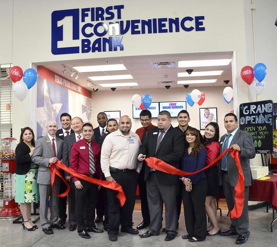 First Convenience Bank officials and staff pose with a representative of the H-E-B Zapata Highway Store as they cut the ribbon Thursday morning to officially open the bank at the store. This marks the sixth local branch for First Convenience Bank. (Photo by Cuate Santos