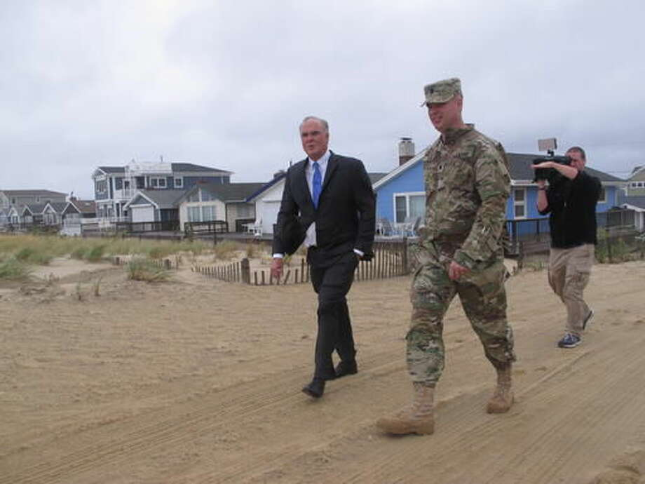 New Jersey Environmental Protection Commissioner Bob Martin, left, and Lt. Col. Michael Bliss of the U.S. Army Corps of Engineers inspect a beach in Toms River, N.J. on Thursday Sept. 29, 2016. A massive project to build protective sand dunes in the section of the Jersey shore hardest hit by Superstorm Sandy four years ago will begin soon. (AP Photo/Wayne Parry)
