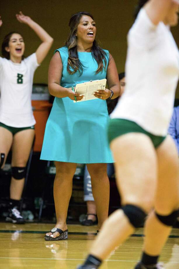 McCollum coach Rose Ann Martinez looks on during a volleyball game between McCollum Cowboys and Southside Cardinal at McCollum High School in San Antonio, Texas on October 21, 2016. Photo: Ray Whitehouse /For The Express-News