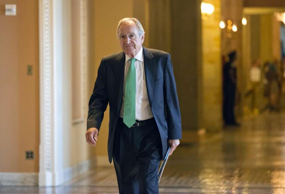 Sen. Tom Harkin, the Iowa Democrat who chairs the Senate's Education Committee, returns to the chamber at the Capitol in Washington, Tuesday, July 16, 2013. As a bipartisan group of senators inched closer Wednesday to a compromise that would reduce interest rates on student loans before classes resume, Harkin insists that the caps on interest rates were still too high. (AP Photo/J. Scott Applewhite)