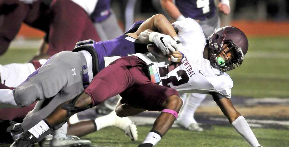 Cental running back Deshon Moreaux is brought down by Port Neches-Groves defender Logan LeJeune during a first quarter run on Friday in Port Neches. (Mike Tobias/The Enterprise) Photo: Mike Tobias/The Enterprise