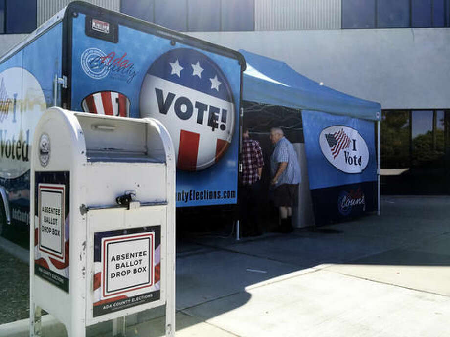 Idaho voters head to a new food truck-inspired voting unit in Boise, Idaho on Tuesday, Sept. 27, 2016. The four new trailers will be parked throughout the state's most populated county in the three weeks leading up to the November election and allow Idahoans to vote early without going to their designated precinct. (AP Photo/Kimberlee Kruesi)