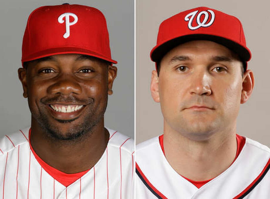 "FILE - These are 2016 file photos showing Philadelphia Phillies' Ryan Howard, left, and Washington Nationals' Ryan Zimmerman. Al-Jazeera is asking a judge to dismiss defamation lawsuits filed by two Major League Baseball players over statements made in a documentary about performance-enhancing drugs in sports. Lawyers for the publication and for Ryan Zimmerman of the Washington Nationals and Ryan Howard of the Philadelphia Phillies are to appear in court Tuesday in U.S. District Court in Washington. The suits refer to the documentary ""The Dark Side: Secrets of Sports Doping,"" which Al-Jazeera America broadcast in December 2015. (AP Photo/File)"