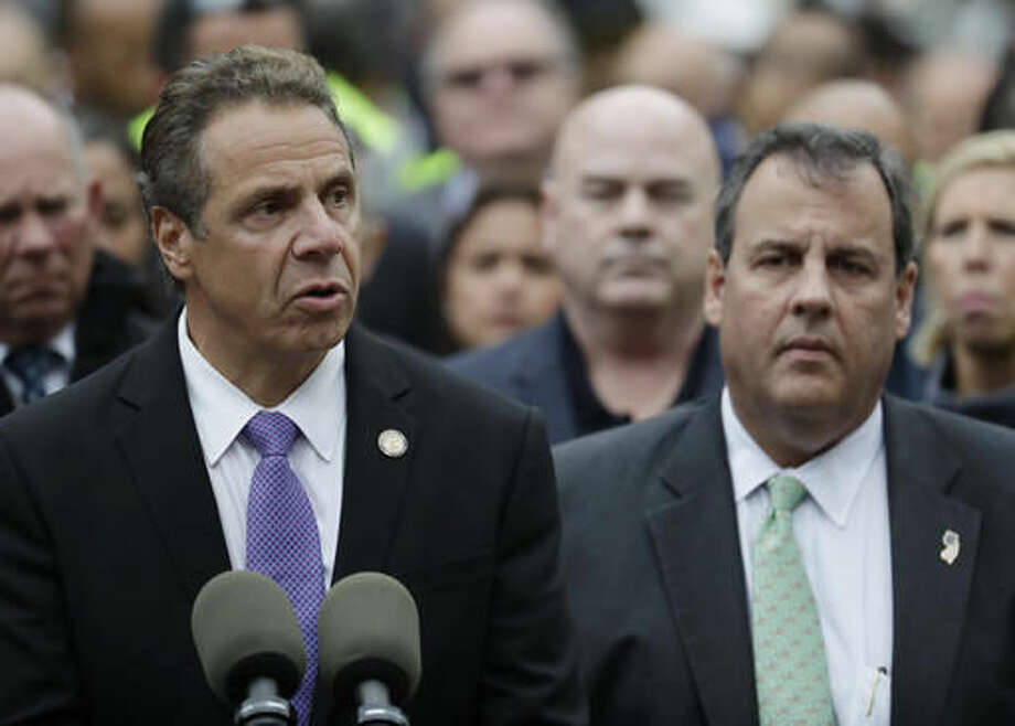 New York Gov. Andrew Cuomo, left, speaks during a news conference on the train crash at the Hoboken Terminal as New Jersey Gov. Chris Christie, right, listens, Thursday, Sept. 29, 2016, in Hoboken, N.J. A commuter train crashed into the rail station during the morning rush hour, causing serious damage and injuring dozens. (AP Photo/Julio Cortez)