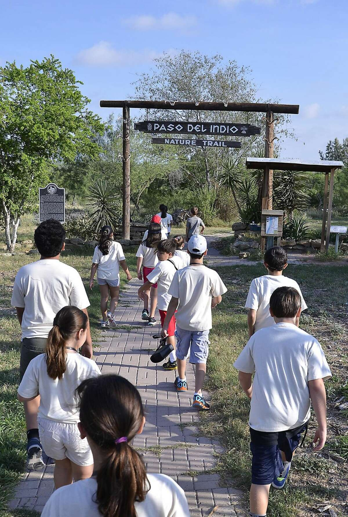 Lamar Bruni Vergara Envionmental Center's Environmental Science Camp participants make their way to the banks of the Rio Grande at the Paso del Indio Nature Trail Tuesday morning. (Photo by: Cuate Santos