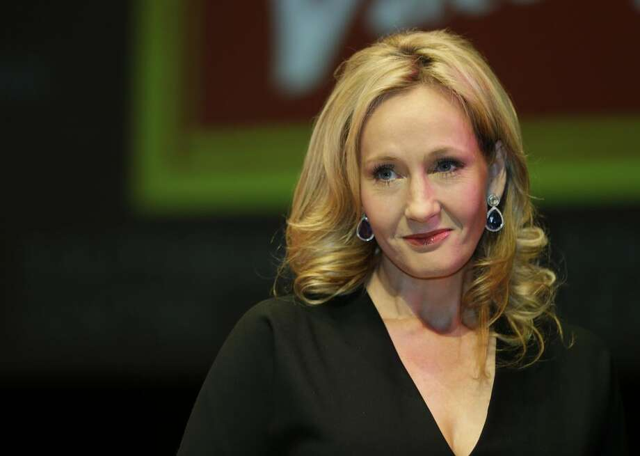 "This is a Thursday, Sept. 27, 2012 file photo of British author J.K. Rowling as she poses for the photographers during photo call to unveil her new book, ""The Casual Vacancy,"" at the Southbank Centre in London. (AP Photo/Lefteris Pitarakis, File)"