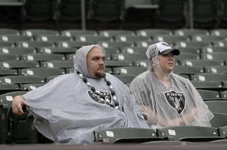 Oakland Raiders fans are shown before an NFL football game between the Oakland Raiders and the Kansas City Chiefs in Oakland, Calif., Sunday, Oct. 16, 2016. (AP Photo/Marcio Jose Sanchez)
