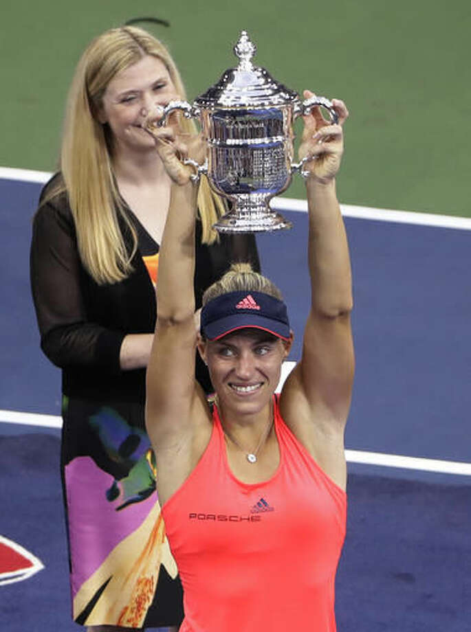 Angelique Kerber, of Germany, holds the champions trophy after defeating Karolina Pliskova, of the Czech Republic, during the women's singles final of the U.S. Open tennis tournament, Saturday, Sept. 10, 2016, in New York. (AP Photo/Seth Wenig)