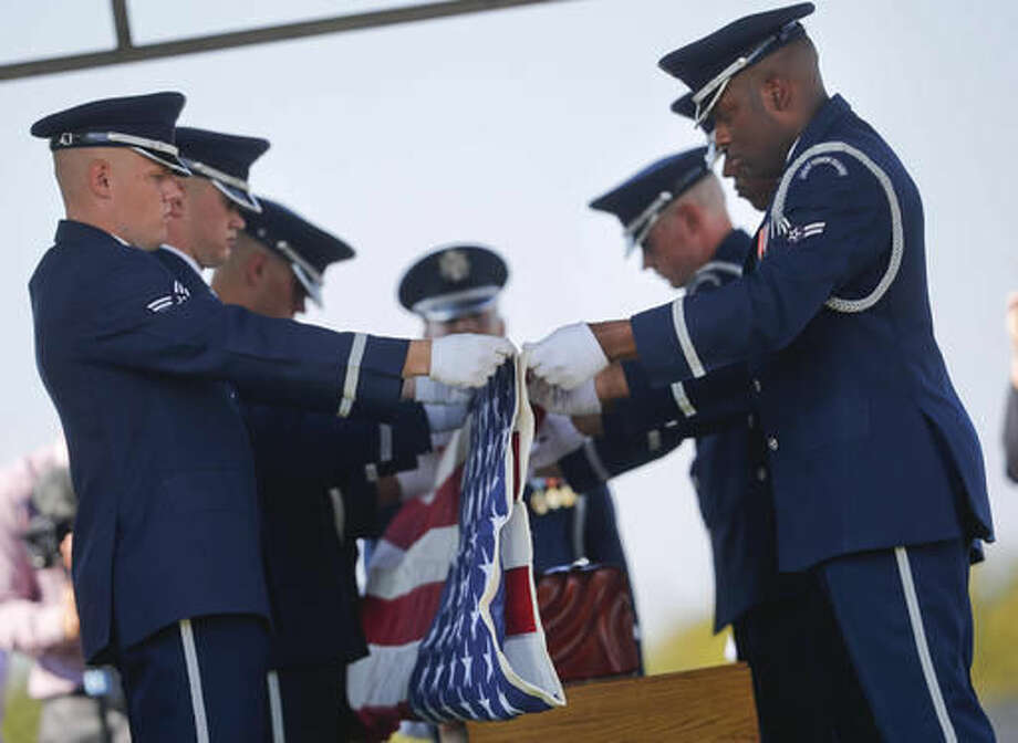 Members of the Air Force Honor Guard begin to fold an American flag during burial services for World War II pilot Elaine Danforth Harmon, during burial services, Wednesday, Sept. 7, 2016 at Arlington National Cemetery in Arlington, Va. It took an act of Congress, but Harmon was finally laid to rest on at Arlington National Cemetery, she died last year at age 95. She was one of the Women Airforce Service Pilots (WASP), a group of women who flew military aircraft on noncombat missions during World War II so that men were freed up for combat. (AP Photo/Pablo Martinez Monsivais)
