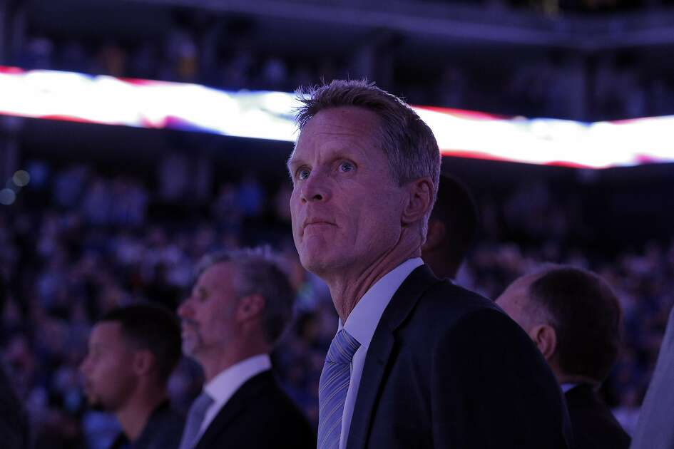 Warriors head coach Steve Kerr during the national anthem before the Warriors played the Portland Trail Blazers during a pre-season game at Oracle Arena in Oakland, Calif., on Friday, October 21, 2016.