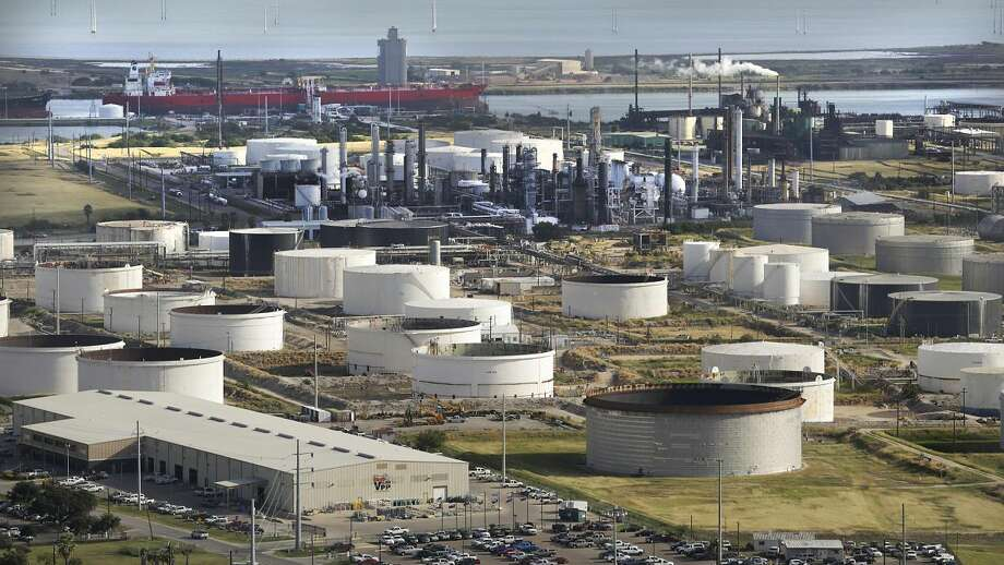 This Oct. 28, 2013, ariel photo shows Valero offices, left, and Citco storage containers right, in Corpus Christi, Texas. (AP Photo/The San Antonio Express-News, Bob Owen)