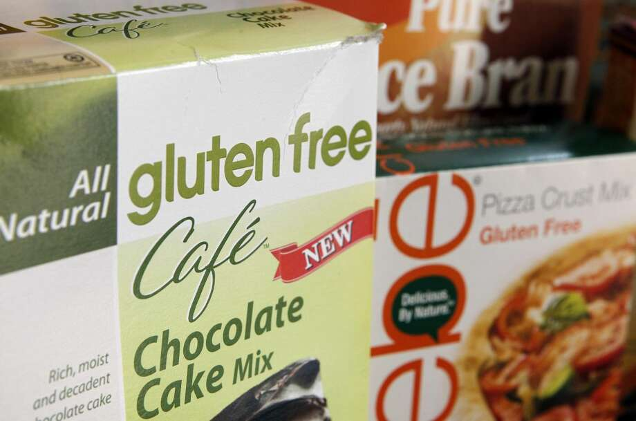 A variety of foods labeled Gluten Free are displayed in Frederick, Md., Friday, Aug. 2, 2013. (AP Photo/Jon Elswick)