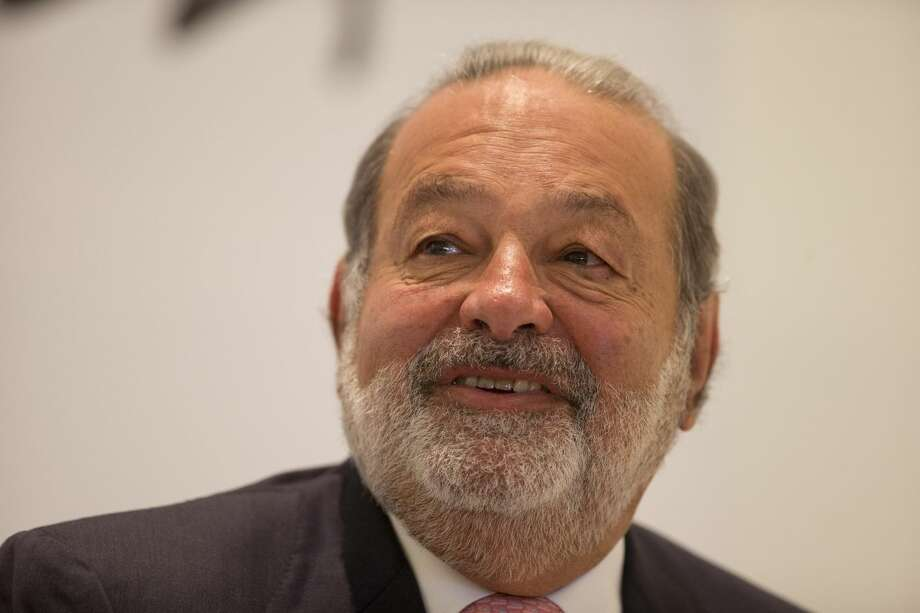 In this Jan. 14, 2013 file photo, Mexican telecommunications tycoon Carlos Slim speaks during news conference at the Soumaya museum in Mexico City. (AP Photo/Dario Lopez-Mills, File)