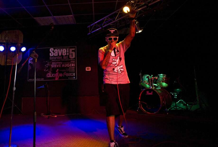 Singer Yung Tony Hawk Music (stage name) performs on stage at Average Joe's Sports Bar on Sunday afternoon during the AutmusFest Got Talent Event. The event was held to have musicians compete for a spot on the AutmusFest lineup. (Photo by Danny Zaragoza
