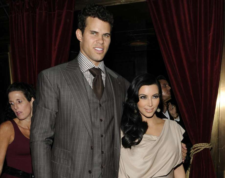This Aug. 31, 2011 file photo shows Kim Kardashian and Kris Humphries attending a party thrown in their honor at Capitale in New York. The couple's divorce is unlikely to be concluded before the end of the year, with Humphries' attorneys seeking detailed records from companies that handle the reality starlet's shows and the depositions of her mother-manager Kris Jenner and current boyfriend Kanye West. Kardashian, 31, and Humphries, 26, were wed Aug. 20 in a star-studded, black-tie ceremony at an exclusive estate in California. (AP Photo/Evan Agostini, file)