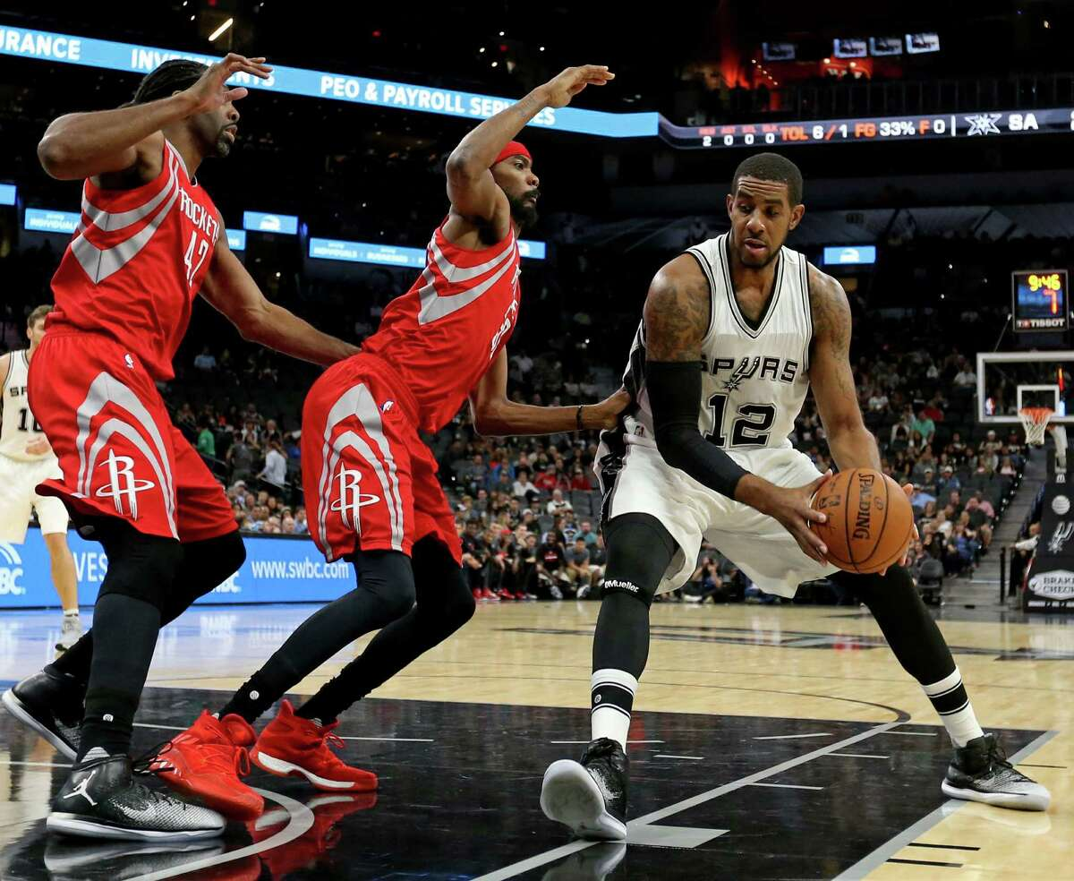 San Antonio Spurs' LaMarcus Aldridge looks for room around Houston Rockets?• Nene (left) and Corey Brewer during first half action of their preseason game held Friday Oct. 21, 2016 at the AT&T Center.
