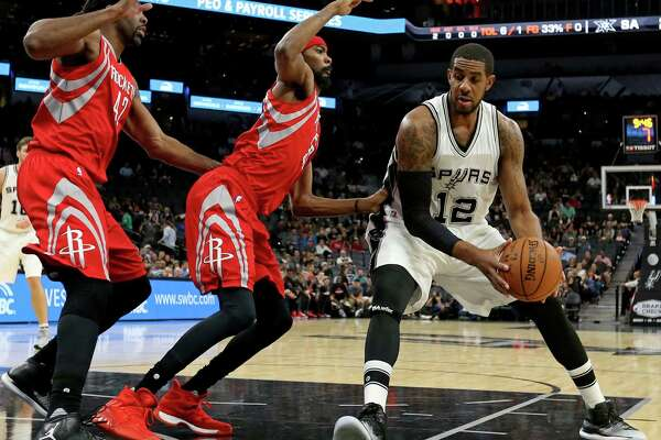 San Antonio Spurs' LaMarcus Aldridge looks for room around Houston Rocketsé• Nene (left) and Corey Brewer during first half action of their preseason game held Friday Oct. 21, 2016 at the AT&T Center.