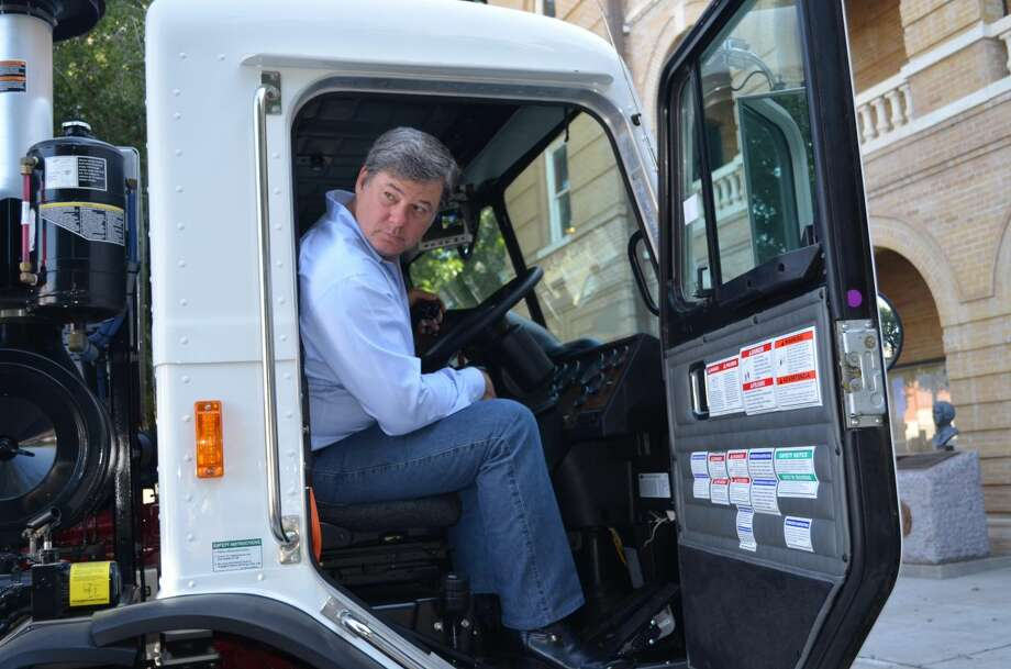 Webb County Commissioner John Galo tests the equipment of one of the three new trash trucks recently added to the fleet at the Road and Bridge Department. The trucks were displayed at the Webb County Courthouse Friday morning and will be used to service the growing needs of the residents of Webb County. (Courtesy photo)