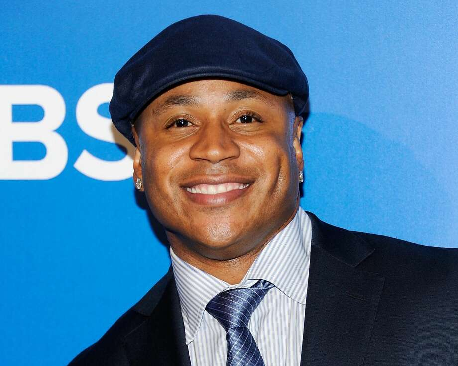 "This May 16, 2012 file photo shows ""NCIS: Los Angeles"" cast member LL COOL J at the CBS network upfront presentation at The Tent at Lincoln Center in New York. Los Angeles police say the rapper grabbed and held a burglary suspect at his Studio City home Wednesday morning. Police got a 911 call shortly before 1 a.m. from someone who said her father had spotted an intruder in their home and was holding him downstairs. Officers arrived and took a man into custody. Police say he had minor bruises and will be arrested on suspicion of burglary. His name hasn't been released. LL Cool J wasn't hurt and apparently nothing was taken.(AP Photo/Evan Agostini, file)"