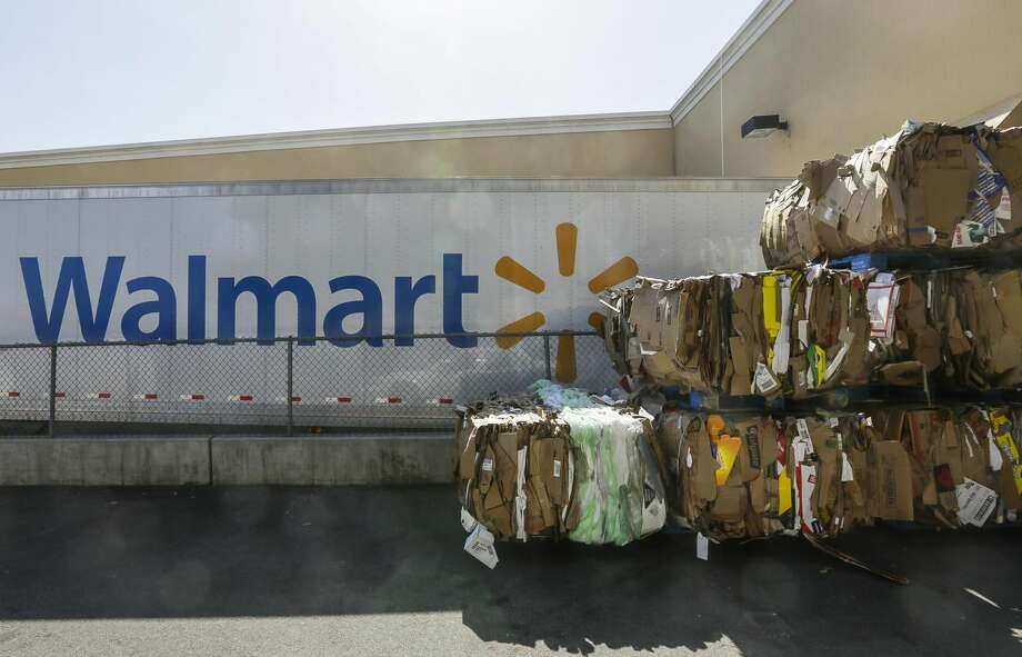 In this May 28, 2013, file photo, recycled cardboard boxes are ready for transport outside a Walmart store in Duarte, Calif. Wal-Mart agreed Wednesday, Aug. 7, 2013, to improve safety conditions for employees who use trash compactors and cleaning chemicals at more than 2,800 stores as part of a settlement agreement with the Labor Department.. (AP Photo/Damian Dovarganes, File)