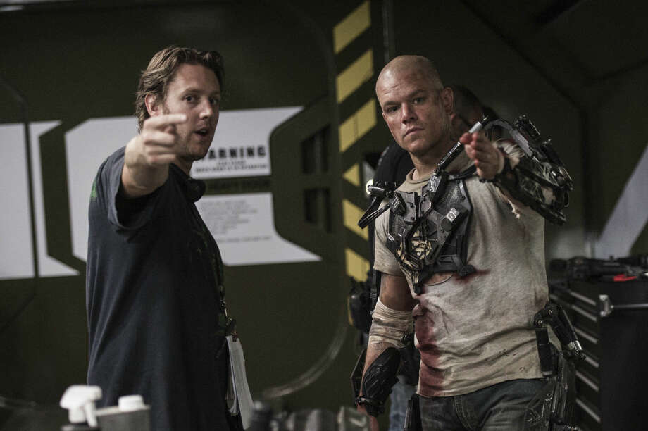 "This film image released by Columbia Pictures-Sony shows director Neill Blomkamp, left, and Matt Damon on the set of ""Elysium."" The film, opening nationwide on Aug. 9, is a rogue burst of originality _ a futuristic popcorn adventure loaded with contemporary themes of wealth discrepancy, immigration and health care. (AP Photo/Columbia Pictures, TriStar, Kimberly French)"
