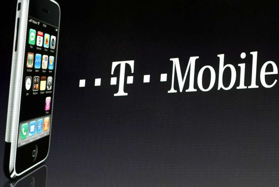 In this Wednesday Sept. 19, 2007 file photo, an iPhone is displayed next to a T-Mobile sign, in Berlin. Unlimited wireless data is back. After sliding off the menu of cellphone plans, data plans with no caps are making a comeback at smaller wireless companies trying to compete with AT&T and Verizon. T-Mobile USA, the nation's fourth-largest cellphone company, said Wednesday, Aug. 22, 2012, that it will start selling an unlimited-data plan again on Sept. 5, (AP Photo/Markus Schreiber, File)