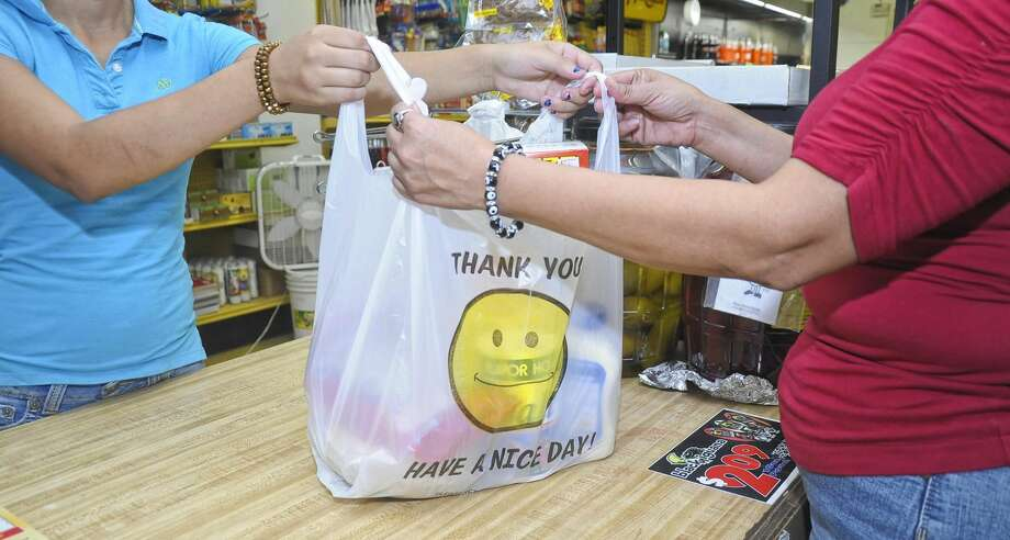 A shopper has his items placed in a plastic bag at G's Meat Market. (Photo by Ulysses S. Romero, File/Laredo Morning Times)