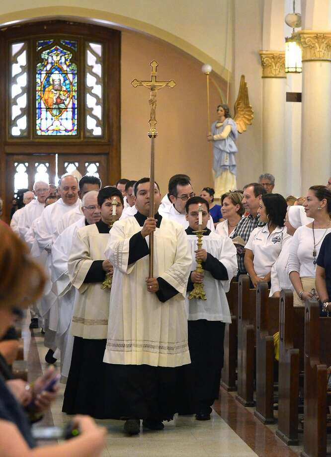 A procession of clergy with the Catholic Diocese of Laredo makes it way into San Agustin Cathedral on Friday afternoon, where Bishop James Tamayo celebrated a Mass to in honor of the diocese's 13th anniversary. (Photo by Cuate Santos/Laredo Morning Times)
