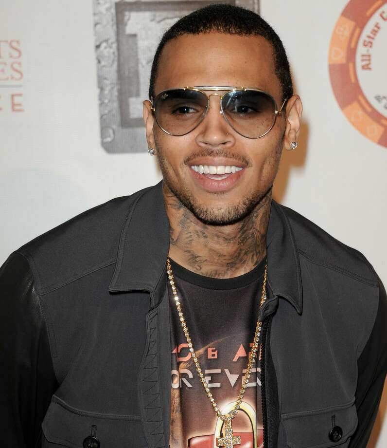 FILE - In this Monday, July 15, 2013 file photo, Chris Brown arrives at the 8th Annual Bear Trap Entertainment All-Star Celebrity Kickoff Party at the Playboy Mansion in Los Angeles. Brown was sued Tuesday, Aug. 13, 2013, by Sha-keir Duarte, who claims he was punched and kicked by a member of Brown's entourage during a fight at a West Hollywood recording studio in January. Brown's lawyer Mark Geragos called the battery and infliction of emotional distress case a shakedown and vowed to get it dismissed. (Photo by Richard Shotwell/Invision/AP, file)