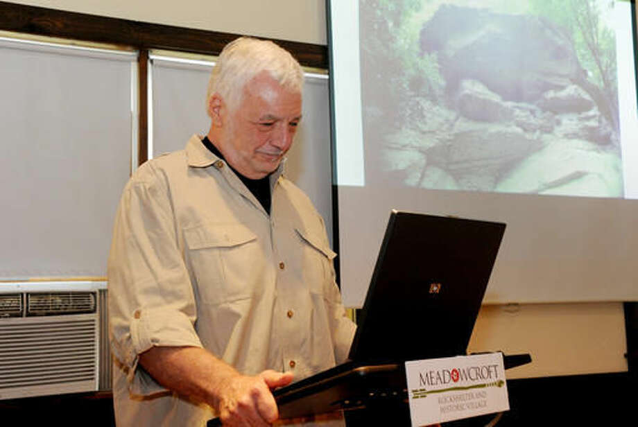 In this Aug. 27, 2016, James Adovasio, formerly from the University of Pittsburgh, who started the famous Meadowcroft Rockshelter dig, near Avella, Pa., in the 1970s, pauses for a moment while giving a lecture at the Meadowcroft Visitor's Center in Avella. The site yielded fossils from humans 16,000 years ago, which at the time represented the oldest ever found in North America. (Lake Fong/Pittsburgh Post-Gazette via AP)